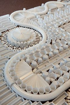 We're revisiting the work of We Make Carpets because, well, they've been up to a lot lately! My favorite recent installation of their now famous non-textile carpet installations is this giant one made from plastic utensils, cups and containers.