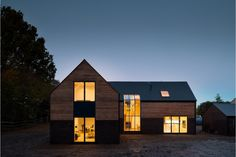 This new build country house near Hawkhurst, in Kent, hopes to provide the best of both traditional rural tactility and modern contemporary living.