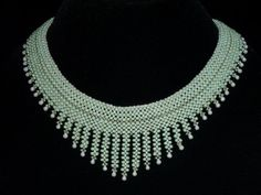 """Artbeads.com Jewelry Design Star Round 11 Winner - Venita Holzer - """"Spring Mist"""" he collar is made entirely of right angle weave using peanut beads (farfalle beads), seed beads and drop beads'"""