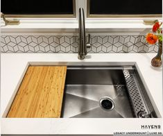 This unique tiered sink with a stain-resistant professional cutting board and an innovative sponge caddy make this home kitchen feel like a luxurious gourmet space! The perfect combination of functionality and beauty 🔥🔥🔥 #kitchengadgets #styledforliving #chefskitchen #kitchenessentials #hgtvaddict #kitchen #customhomes Undermount Stainless Steel Sink, Stainless Steel Cleaner, Stainless Kitchen, Stainless Steel Types, Undermount Sink, Sink Accessories, Washing Dishes, Home Chef, Basin