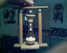 How to make an hour glass from two lightbulbs... LOVE IT ~!~