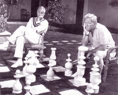 Spencer Tracy & Charlie Farrell playing giant chess at the Racquet Club of Palm Springs.