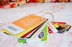 Punch a hole in all store cards and put them on a ring :D