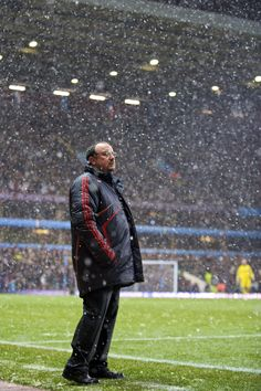 Rafa Benitez looks on as the snow tumbles down at Villa Park