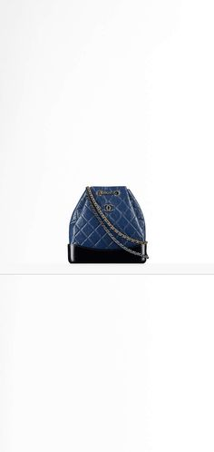 CHANEL's GABRIELLE backpack, aged calfskin, smooth calfskin, silver-tone & gold-tone metal-beige & black - CHANEL
