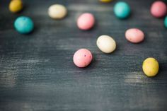 pastel colored easter eggs on gray background