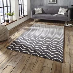 Composed of a zig zag design with a background made up of a grey colour gradient, this rug sits perfectly in any contemporary interior space. The thick luxurious pile adds warmth to your room and is hand-made with 100% wool.