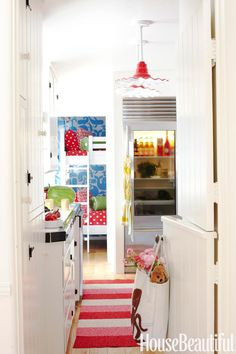 A Dutch door opens to the kitchen and a children's room beyond. Stripes, polka dots, and big blue whales are a surprisingly compatible mix.   - HouseBeautiful.com