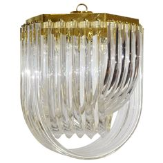 Lucite & Brass Swag Chandelier | From a unique collection of antique and modern chandeliers and pendants at https://www.1stdibs.com/furniture/lighting/chandeliers-pendant-lights/