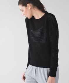 """Release Date: 4/2015. Original Price: $118. Materials: Primo Cotton Yarns. Color: black. Why we made this Breathable and cottony-soft, this lightweight pullover is our new post-practice favourite. The loose fit layers easily over a tank and tights when we're leaving the studio, and the open hole knit gives our sticky skin room to breathe after a particularly sweaty class. This is what we mean when we say """"hold on to your bliss.""""Key features made with naturally breathable and soft primo… Lululemon, Tights, Pullover, Yarns, Loose Fit, Breathe, Bliss, Cotton, Color Black"""