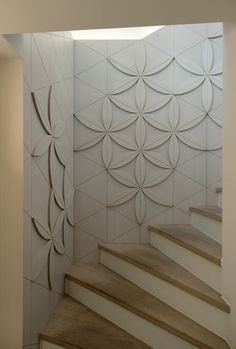 Love these 3D geometric flowers. Immediately creates tactility whilst maintaining a pattern. Restaurant Kaserei Murten - By Grego #stairs #staircase