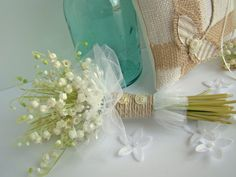 lily of the valley...simple and cute. like the jute and button handle