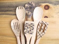 Wood burned kitchen utensils bamboo wooden spoons by HydeParkHome, $30.00. O.K. so I'm not a great fan of decorating the business end of cooking utensils but I have to admit I really do like this set. In particular the way the patterns get reflected in the handels, not over done just a few lines makeing a nicely balanced contrast to the main pattern. Good idea for other projects too ;)
