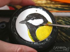 Earring with chickadee in progress, painted on light wooden plate. Each earring in pair is always different!