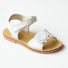 Covered with perforated detailing, this leather sandal with gerbera flower applique is the sandal of choice for refreshing style on warm days. Note: Sizes 5-13 (Toddler), 1-2 (Youth)