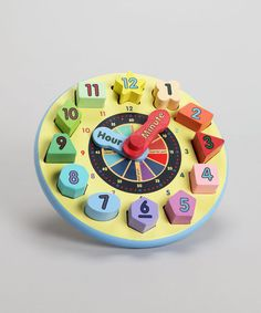 The time to teach is now! This engaging clock is a wonderful way to introduce a little learner to the concept of telling time. Each number block has a different unique shape and a special spot on the clock face. It even features movable hour and minute hands, just like the real thing!4.2'' H x 8.8'' diameterMedium-density fiberboard / solid wood / plywood...