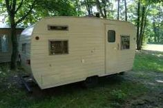 Vintage Holly Travel Trailer-our family of 5 enjoyed camping  in a Holly like this.Holly was in business 1947-1964.