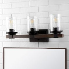 The squared design of this wall sconce gives it a pared-down Craftsman look. A minimalist matte-black finish and cylinder shade add low-key style over a kitchen sink or bathroom mirror. Use several as wall sconces down a hallway. Led Vanity Lights, Bathroom Vanity Lighting, Candle Sconces, Wall Sconces, Modern Cottage, Bath Vanities, Glass Collection, Oil Rubbed Bronze, Rustic Farmhouse