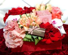 Won't you be my Valentine? This arrangement overflowing with flowers sits inside a beautiful red box and contains luscious pink and red roses, fabulous tulips and white orchid blossoms is a sure fire way to melt your Valentine's heart. Tucked inside the flowers is a fragrant rose scented Diptyque candle and a beautiful box of Valerie chocolates. $275.00