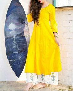 Buy The Secret Label Yellow Cotton Solid Anarkali Kurti online in India at best price.Yellow is the colour of spring and what better way to flaunt it than this bright kalidaar tunic that Stylish Dresses, Trendy Outfits, Girl Outfits, Fashion Outfits, Summer Outfits, Indian Dresses, Indian Outfits, Yellow Kurti, Diwali Outfits