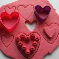 Sensory play on the blog today. Homemade rose scented no cook play dough with beads and heart shaped cookie cutters.