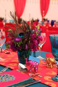 Love the peacock and elephant centerpiece - very exotic!