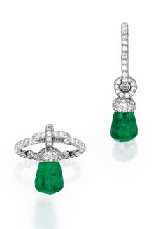 Briolette Emerald and Diamond Ring, The briolette emerald measuring approximately 8.1 by 7.8 mm, suspended from a band set with numerous round diamonds weighing approximately 1.60 carats, size 2½, inclusive of sizing spheres, unsigned, with indistinct workshop marks and stamped PT950. JAR, Paris Estimate: 20,000 – 30,000 USD LOT SOLD:  110,500 USD