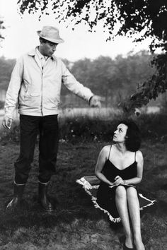 Director Michelangelo Antonioni gives directions to Jeanne Moreau on the set of La Notte, 1961.