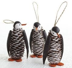 Pinecone penguin with a wooden ball for the head, bamboo skewer for the beak and pine cone body