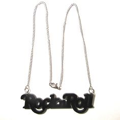 'RocknRoll' black acrylic laser-cut pendant, on 46cm silver plated curb chain. Rock and roll!