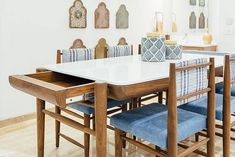 Excellent design for a teak wood dining table with storage for linen and marble top. #furniture