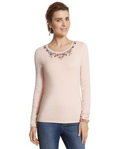 The scoop neck long-sleeve sweater garners attention with a bejeweled scoop neckline.