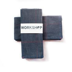 """Our Workshop Collection is a classic, yet fresh take on vintage workwear.  We use 100% American cotton denim that is double-stitchedand finished with  a bar tack in a contrasting color. Our tablerunners, placemats and napkins  are unique, casual and comfortable addition to your table.      * Set of two dinner napkins     * Bar tack on each corner, three goldenrod and one red     * 100% American cotton denim     * Made in the USA     * 18"""" x 18""""     * Machine wash cold, dry low, ..."""