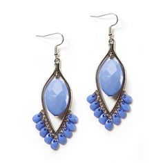 These fishhook style drop earrings feature reverse silver teardrops with opaque faceted periwinkle acrylic stones in the center of each teardrop and hung from the bottom of the earring. Color may vary due to camera.