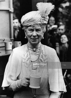 The dowager Queen Mary (1867 - 1953), enjoys a cup of tea during a visit to a YMCA in Cheltenham.  (Photo by Keystone/Getty Images)