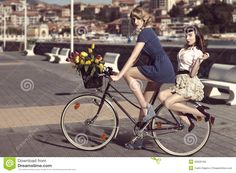 two-vintage-women-bicycle-near-sea-couple-fashion-style-colourful-tulips-basket-bike-color-outdoor-32626195.jpg (1300×958)