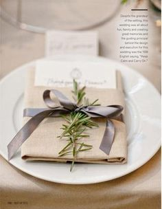 rosemary sprig wedding napkin - we are going for this look- grey satin ribbon, beige/natural colored napkin and sprig of rosemary!! (with ivory satin table cloth)