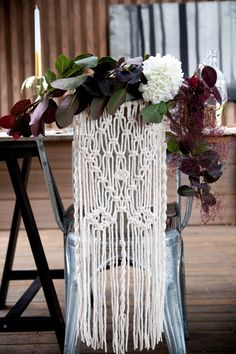 Who says macrame only belongs on the walls? We love the unique placement of it on a chair back