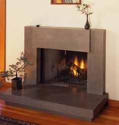 Contemporary Polished Concrete Fireplace Surround - totally want to redo the tile around my fireplace to this!