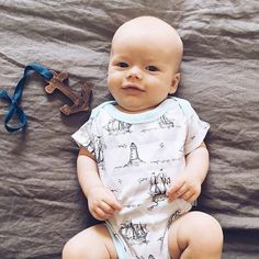 Happy Sunday! Our sailor Collection includes this adorable onesie and wooden teething toy! Thank you, @jessigreen__ for sharing your adorable baby! #finnandemma