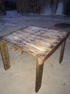 Pallet table. Sanded down and stained, finished with a clear sealer: then painted krypton with marshmallow white trim.
