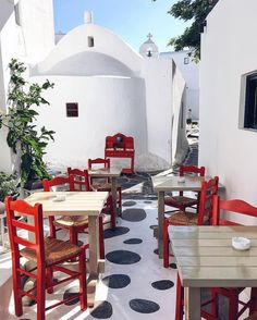 red chairs and all white space