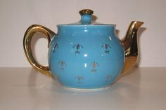Beautiful vintage collectible teapot in turquoise or teal with decorative gold pattern. Cute round shape features gold spout & handle. I couldnt