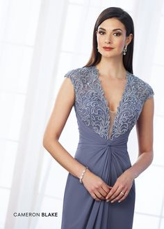 Cameron Blake 217648 - Lace and chiffon slim A-line gown with illusion scalloped lace cap sleeves, plunging V-neckline with illusion modesty panel, hand-beaded lace sweetheart bodice, center gathered natural waist with knot, illusion lace back, sweep train. Matching shawl included.