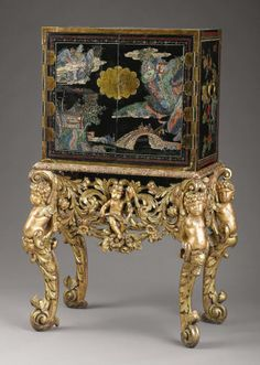 A Chinese Coromandel Style Cabinet on Giltwood Stand The cabinet, Chinese The stand, English Late Century - Available at 2007 November Fine Decorative. Fine Furniture, Antique Furniture, Chinoiserie Chic, American Indian Art, Cabinet Styles, Art Auction, Home Decor Styles, Sculptures, Decorative Boxes