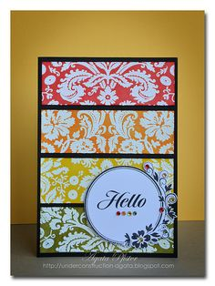 Simple card with white embossed stamps, cut out and adhered to black card stock.