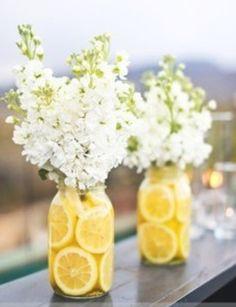 Love the sliced lemons in the mason jar. hides stems, adds sunny flair