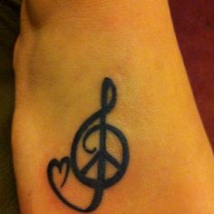 My foot tattoo. Peace love and music.
