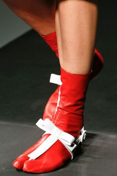 Prada Red Leather Tabi, Spring 2013 RTW. Tabi are traditional Japanese shoes dating back to the 15th century. Ankle-high and with a separation between the big toe and other toes, they are worn by both men and women with traditional thonged footwear.