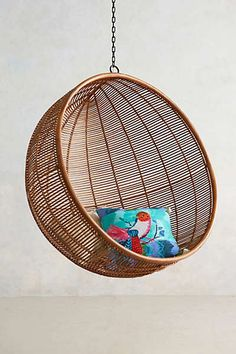 Anthropologie - Rattan Hanging Chair - For down by the chicken coop and garden
